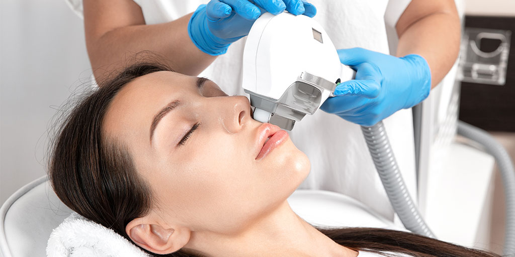 Woman getting IPL treatment on her face